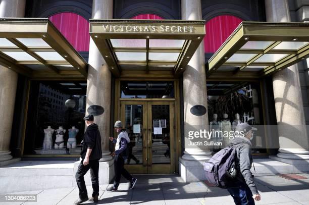 Pedestrians walk by a Victoria's Secret store on February 25, 2021 in San Francisco, California. L Brands, the parent company of Victoria's Secret,...