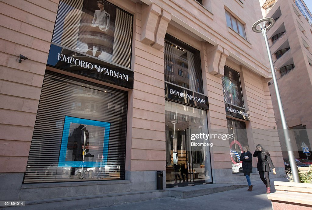2378039496 Pedestrians walk by an Emporio Armani luxury clothing store in ...