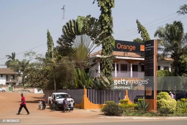 Pedestrians walk by an Orange Bissau SA business services office in Bissau GuineaBissau on Monday Feb 12 2018 The International Monetary Fund said an...