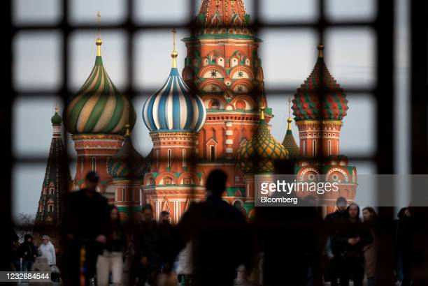 Pedestrians walk by Saint Basil's Cathedral on Red Square in Moscow, Russia, on Sunday, May 2, 2021. Facing a rising wave of Covid-19 infections and...