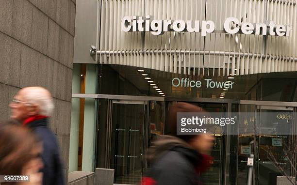Pedestrians walk by the Citigroup Center in New York on Tuesday Jan 16 2007 For all their success arranging mergers securities offerings and loans...