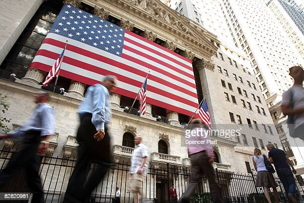Pedestrians walk by the New York Stock Exchange September 15 2008 in New York City In morning trading US stocks suffered a steep loss after news of...