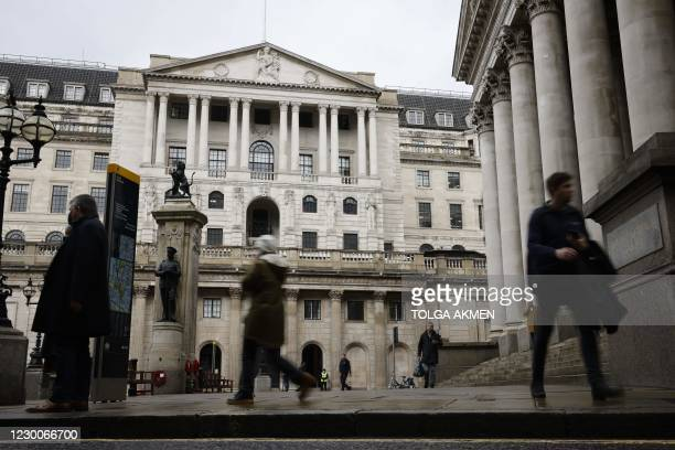 Pedestrians walk by the Royal Exchange and the Bank of England in the City of London on December 11, 2020. - A Brexit trade deal between Britain and...