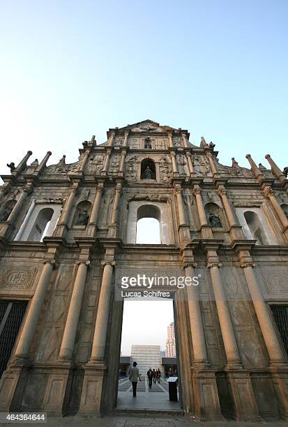 Pedestrians walk by the ruins of St Paul's Cathedral on February 20 2008 in Macau China