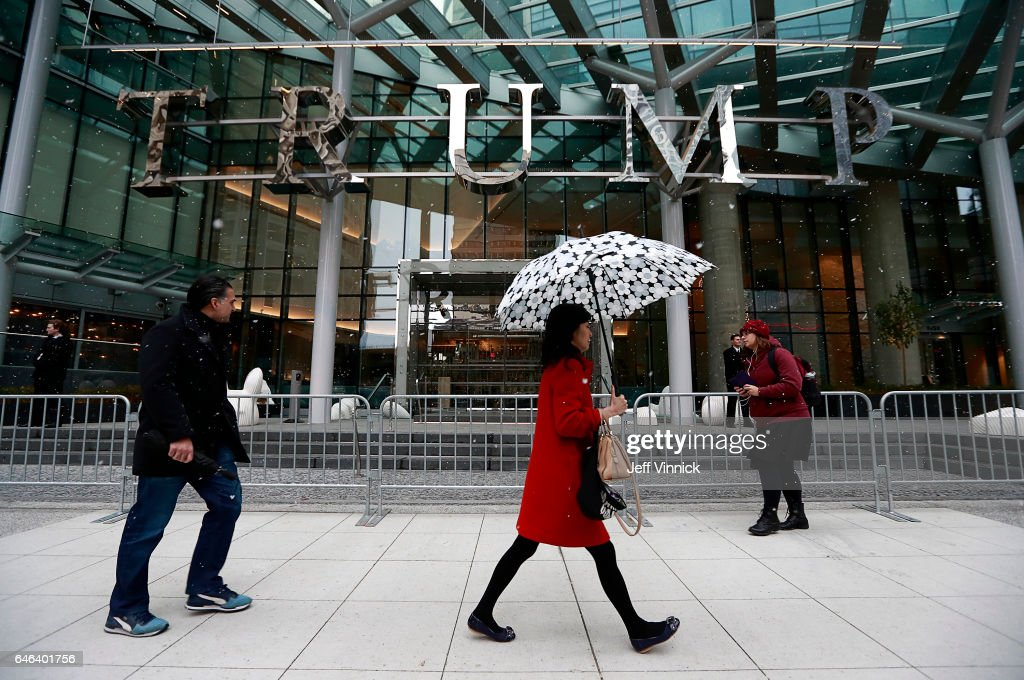 Pedestrians walk by the Trump International Tower and Hotel before a ceremony for the official opening on February 28, 2017 in Vancouver, Canada. The tower is the Trump Organization's first new international property since Donald Trump assumed the presidency.