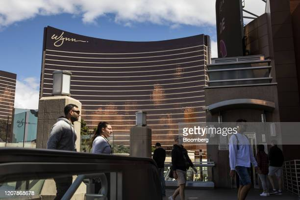 Pedestrians walk by the Wynn Las Vegas resort and casino in Las Vegas, Nevada, U.S., on Tuesday, March 17, 2020. No one has a handle on how vast the...