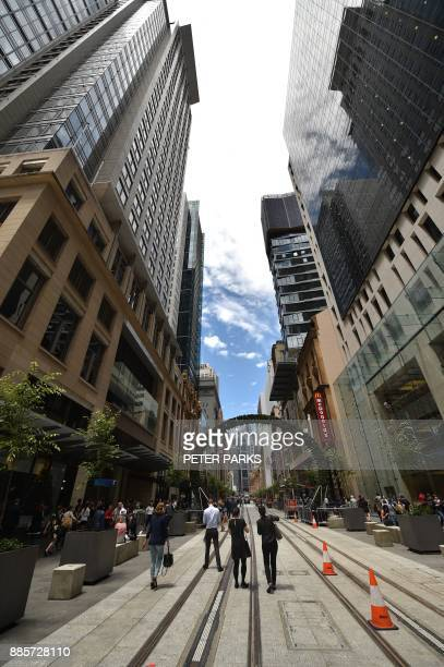 Pedestrians walk down a finished section of George Street where the government is building a light railway system in the central business district of...