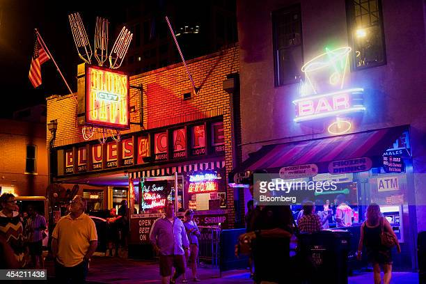 Pedestrians walk down Beale Street at dusk in downtown Memphis Tennessee US on Saturday Aug 16 2014 The US Bureau of Economic Analysis is expected to...