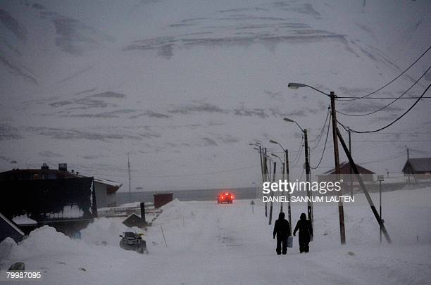 Pedestrians walk down the main street in the arctic town of Longyearbyen on February 25 2008 in Norway A Global Seed Vault has been carved into the...