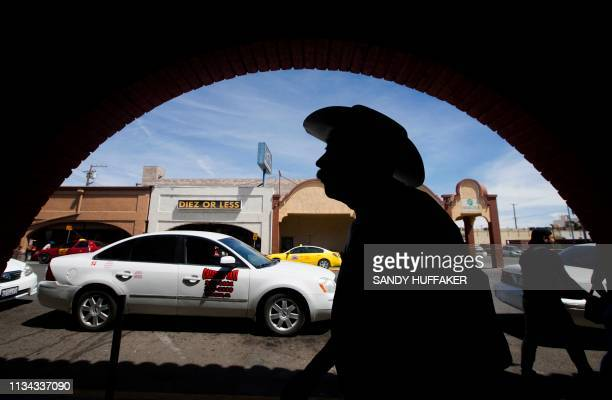 Pedestrians walk in downtown Calexico, California near the Port of Entry to Mexico on April 1, 2019. - US President Donald Trump announced the aid...