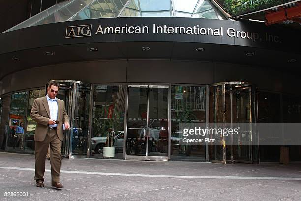 Pedestrians walk in front of a American International Group Inc building September 17 2008 in New York City The Federal Reserve rescued American...