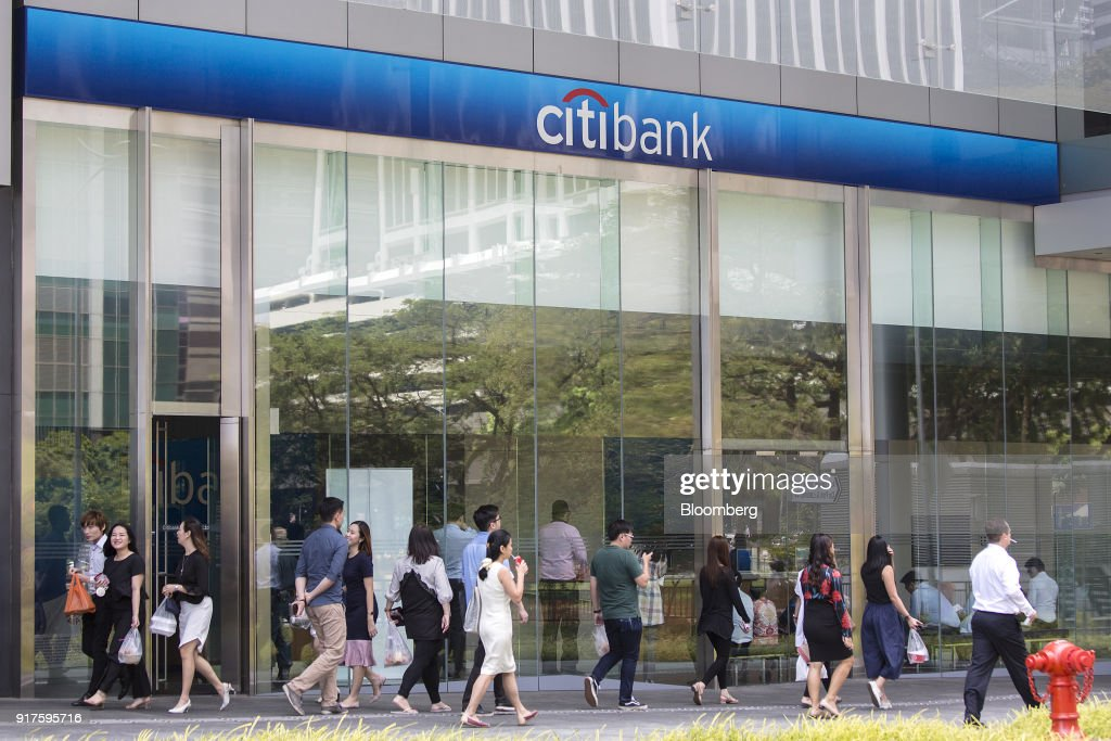 Pedestrians walk in front of a Citigroup Inc  bank branch in the