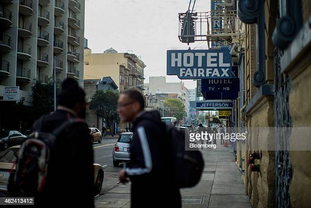 Pedestrians walk in front of the Hotel Fairfax in the Tenderloin district of San Francisco California US on Thursday Jan 15 2015 In a city where...