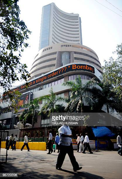 Pedestrians walk in front of the Mumbai Stock Exchange building in Mumbai on January 4 2010 India's stock markets were trading 064 percent higher or...