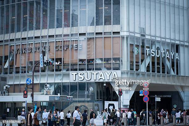 Pedestrians walk in front of the Shibuya Tsutaya media store in the Shibuya district of Tokyo Japan on Wednesday Sept 28 2016 Spotify Ltd is bringing...