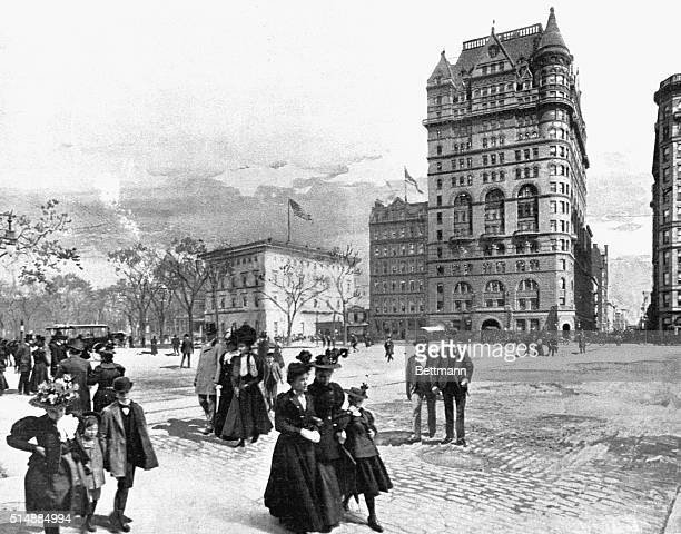 Pedestrians walk in Grand Army Plaza with the Netherland Hotel owned by William Waldorf Astor in the background