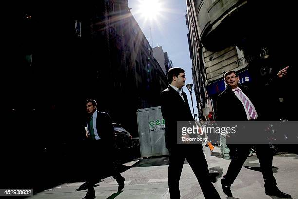 Pedestrians walk in the financial district of Buenos Aires Argentina on Wednesday July 30 2014 A top Argentine banker and former Economy Ministry...