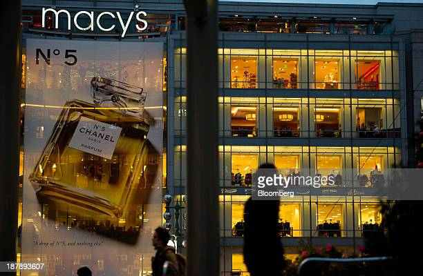 Pedestrians walk in Union Square past a Macy's Inc store in San Francisco California US on Monday Nov 11 2013 The Bloomberg Consumer Comfort Index is...