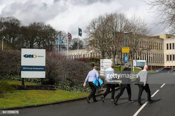 Pedestrians walk into GKN Plc's company headquarters in Redditch UK on Tuesday April 3 2018 Yet another corporate headache has landed on UK Prime...