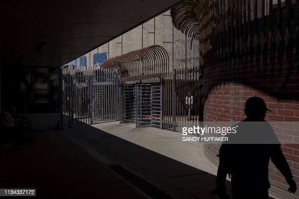 Pedestrians walk into Mexicali, Mexico from Calexico, California at the Port of Entry on on April 1, 2019. - US President Donald Trump announced the...