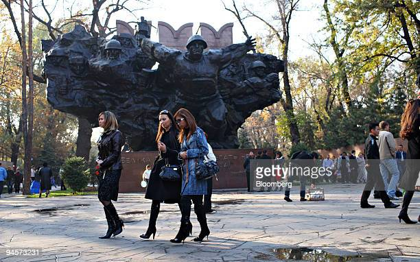Pedestrians walk near a large sculpture in Panfilov Park in Almaty Kazakhstan on Saturday Oct 27 2007