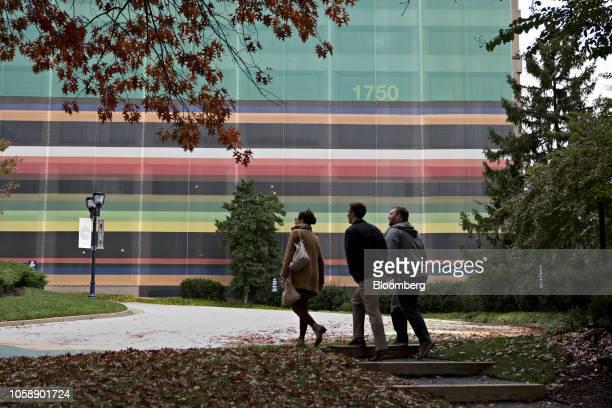 Pedestrians walk near the 1750 Crystal Drive building in the Crystal City area of Arlington Virginia US on Wednesday Nov 7 2018 Seattlebased Amazon...