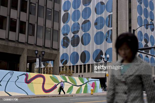 Pedestrians walk near the 1800 S Bell Street building right in the Crystal City area of Arlington Virginia US on Wednesday Nov 7 2018 Seattlebased...