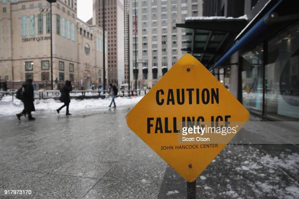 Pedestrians walk near the John Hancock Center one of Chicago's most famous skyscrapers on February 13 2018 in Chicago Illinois John Hancock Financial...