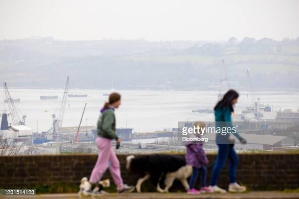 Pedestrians walk near the site of the Devonport freeport in Plymouth, U.K., on Thursday, March 4, 2021. U.K. Chancellor Rishi Sunak unveiled...