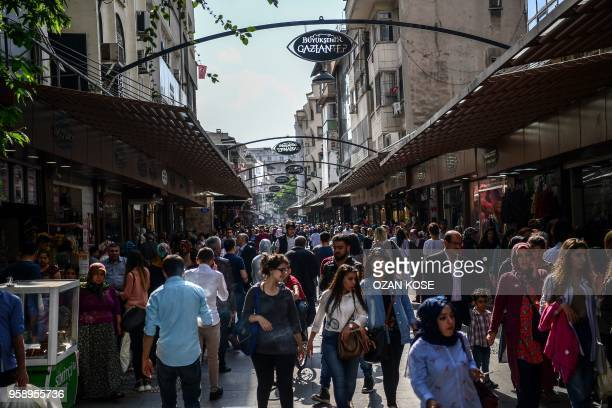 Pedestrians walk on a shopping street in Gaziantep in the southwest province of Turkey on May 1 2018 In the Turkish city of Gaziantep home to around...