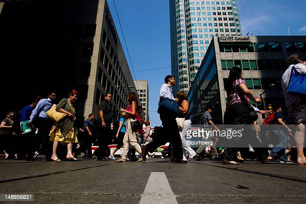 Pedestrians walk on Bay Street in the financial district of Toronto Ontario Canada on Wednesday July 18 2012 The Bank of Canada said consumers and...
