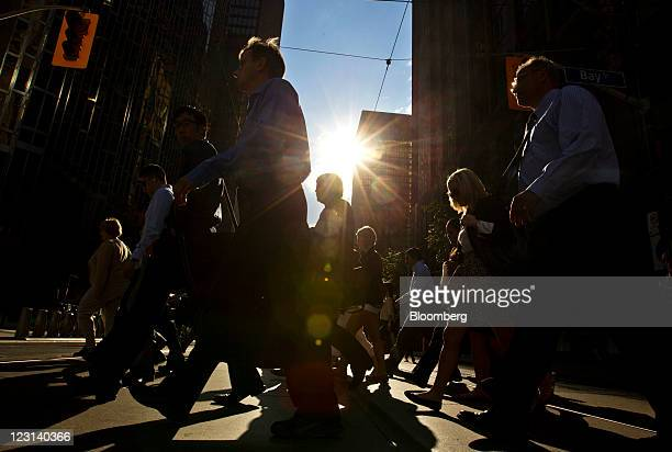 Pedestrians walk on Bay Street in Toronto Ontario Canada on Monday Aug 29 2011 Bay Street is the center of Toronto's Financial District and is often...