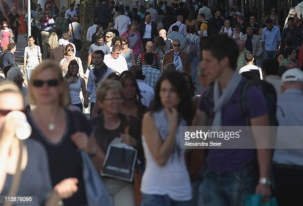Pedestrians walk on May 9 2011 in the city center of Munich Germany Germany has launched its 2011 census nationwide with over 6000 volunteer...