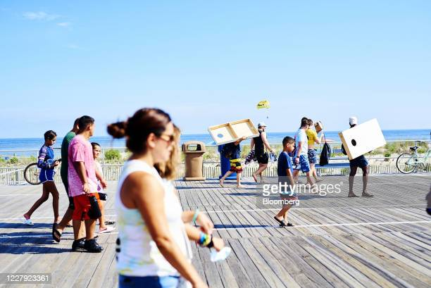 Pedestrians walk on the boardwalk in Ocean City, New Jersey, U.S., on Saturday, Aug. 1, 2020. From California's wine country to Colorado's ski towns...