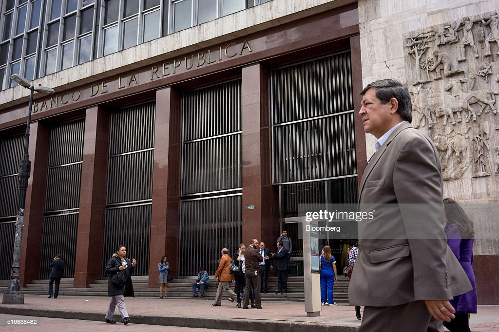 Pedestrians walk outside Banco de la Republica, Colombia's central bank, in Bogota, Colombia, on Tuesday, March 15, 2016. Colombia's central bank raised its benchmark interest rate for a seventh straight month as the inflation outlook continued to worsen and economic growth unexpectedly accelerated. Photographer: Mariana Greif Etchebehere/Bloomberg via Getty Images