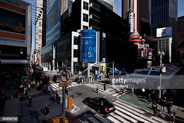 Pedestrians walk outside Morgan Stanley headquarters in New York US on Monday Sept 21 2009 Morgan Stanley and Goldman Sachs Group Inc became bank...