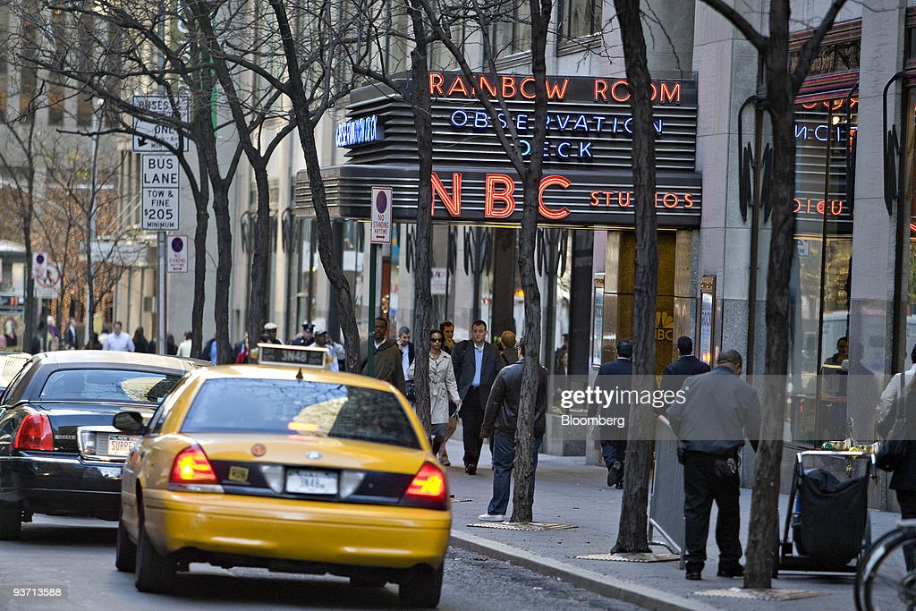 Pedestrians walk outside NBC Studios in New York, U.S., on Thursday, Dec. 3, 2009. Comcast Corp., the largest U.S. cable television company, will start a joint venture with General Electric Co.'s NBC Universal unit, creating an entertainment company valued at about $37 billion. Photographer: Daniel Acker/Bloomberg via Getty Images