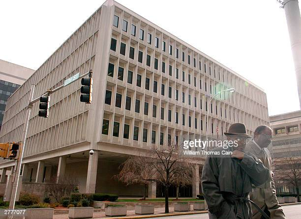 Pedestrians walk outside the J Caleb Boggs Federal Building during a break in a trial brought against DaimlerChrysler AG by Kirk Kerkorian December 2...