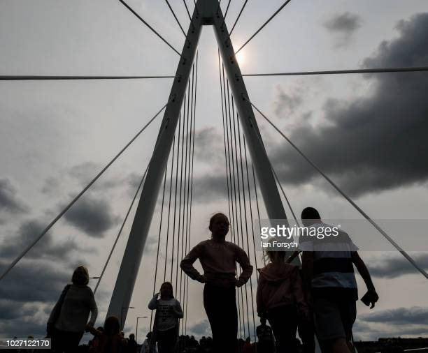 Pedestrians walk over the new Northern Spire bridge spanning the River Wear as it opens for a pedestrian walkover on August 28 2018 in Sunderland...