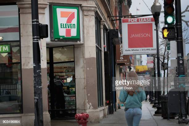 Pedestrians walk past a 7Eleven store on January 10 2018 in Chicago Illinois Immigration officials raided nearly 100 7Eleven stores across the...