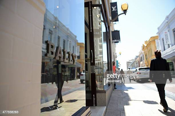Pedestrians walk past a Bally International AG store on King Street in Perth Australia on Thursday March 6 2014 The Western Australia state...