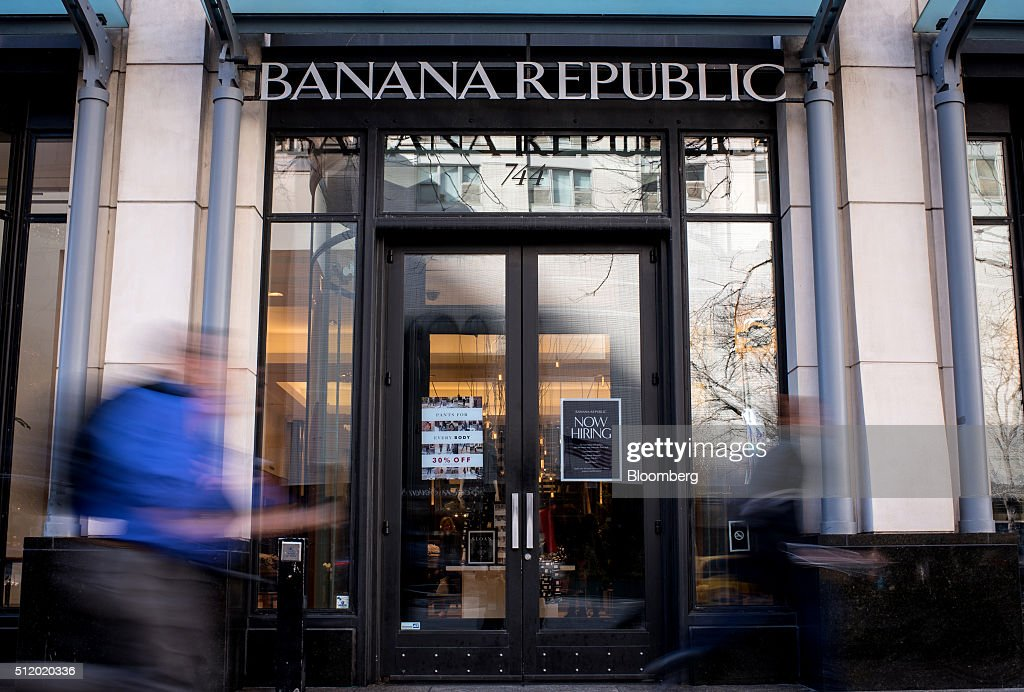 Pedestrians walk past a Banana Republic LLC store in Chicago