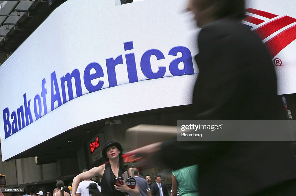Pedestrians walk past a Bank of America Corp. branch in New York, U.S., on Wednesday, July 18, 2012. Bank of America Corp., the second- biggest U.S. lender, plans to trim $3 billion in annual expenses from investment banking, trading and wealth-management units. Photographer: Scott Eells/Bloomberg via Getty Images