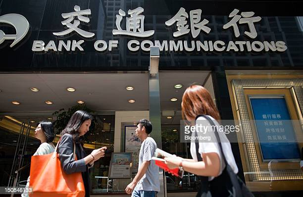 Pedestrians walk past a Bank of Communications Co branch in Hong Kong China on Monday Aug 27 2012 Bank of Communications is scheduled to announce...