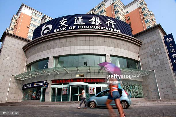 Pedestrians walk past a Bank of Communications Co Ltd branch in Yulin Shaanxi Province China on Saturday Aug 13 2011 Bank of Communications is...