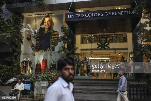 Pedestrians walk past a Benetton Group Srl United Colors of Benetton store in Mumbai India on Friday Dec 15 2017 India's inflation surged past the...