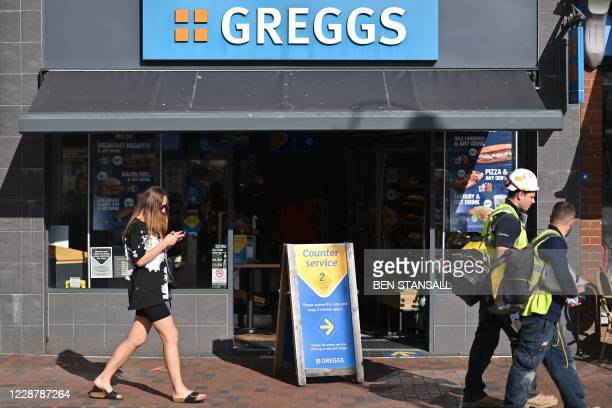 Pedestrians walk past a branch of bakery chain Greggs in the High Sreet of Royal Tunbridge Wells, south west England on September 29, 2020. - High...