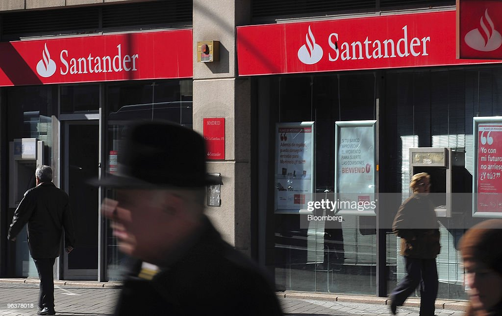 Pedestrians walk past a branch of Banco Santander in Madrid, Spain, on Wednesday, Feb. 3, 2010. Banco Santander announce FY earnings tomorrow. Photographer: Denis Doyle/Bloomberg via Getty Images