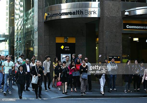 Pedestrians walk past a branch of Commonwealth Bank in the central business district on May 5 2015 in Sydney Australia Forecasters are predicting the...