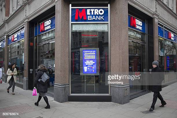 Pedestrians walk past a branch of Metro Bank Plc in London UK on Friday Feb 12 2016 Metro Bank the British lender backed by wealthy American...